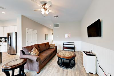 Living Room - Welcome to Rockport! This brand-new property features upscale interior finishes including chic wood-like tile floors throughout.