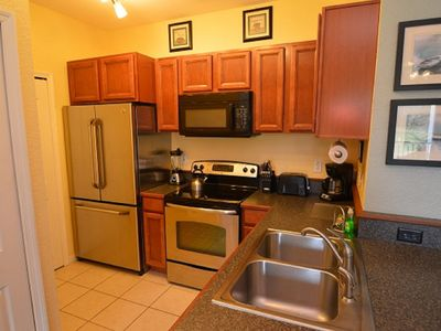 Photo for 11-104 Lake View Condo just 4 miles from Disney World with a heated pool, gym