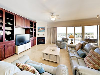 Living Room - Enjoy stunning views of the Intracoastal Waterway and Gulf of Mexico from this 9th-floor getaway at Sailmaker's Place Condominiums in Perdido Key.