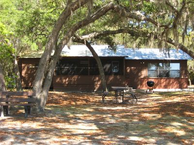 Photo for Lakefront Cottage Near Forest & Cities with canoes, grill, and more!