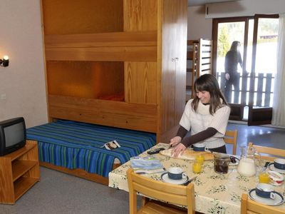 Photo for Surface area : about 20 m². Living room with double bed, 2 bunk beds, sliding door