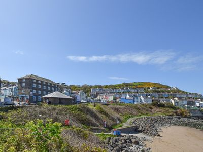 Photo for Beachfront holiday property in New Quay, West Wales. This top floor penthouse apartment looks out ov