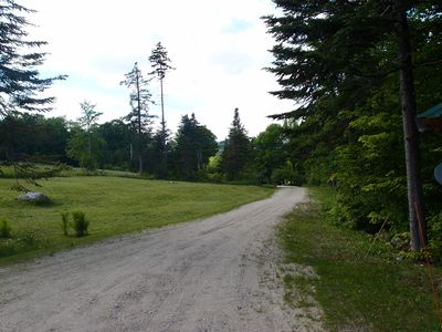 A view down the recently refreshed driveway with the front yard on the left.