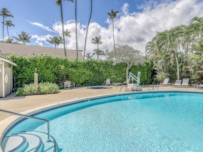 Photo for Ground-floor getaway w/ a furnished patio, shared pools, grills, & shuffleboard