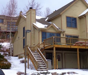 Front of house with large deck facing slopes
