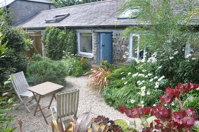 The sunny courtyard garden is ideal for BBQ and outdoor dining