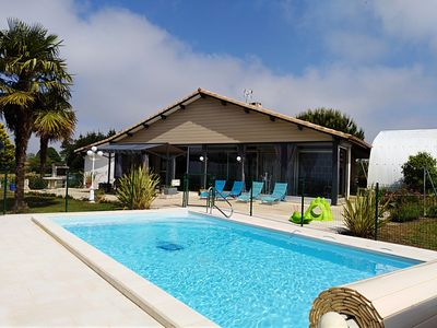 Photo for Comfortable **** villa, private heated pool, fenced park.
