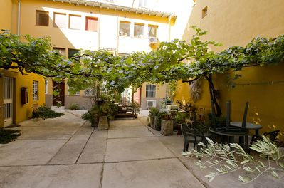 Welcome to the vine covered courtyard!