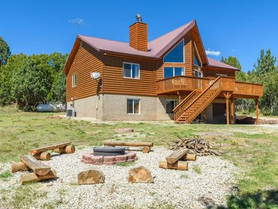 Photo for Amazing cabin with huge outdoor space for the kids! There`s a fire pit out back and a great deck wit