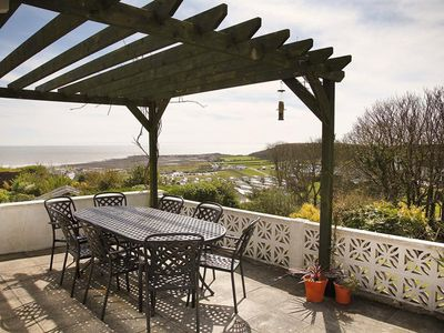 Photo for A fabulous holiday bungalow in a great location with far reaching views over Port Eynon and the coas