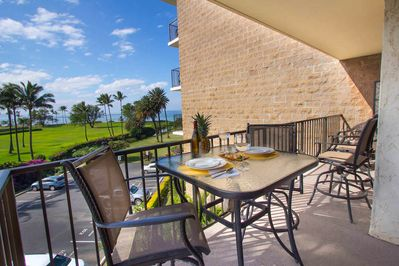 Glass patio table and two chairs on lanai