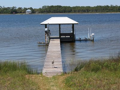 Photo for Beautiful Pet Friendly,  Lagoon Front Home, Pool, Pier and Kayaks  and Much More