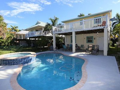 Photo for Welcome to 5560 Palmetto Street.  Located mid island, this four bedroom, three bath pool home is just a two minute walk to the beach and sleeps eight.