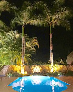 Amazing landscaping & lighting make this villa & pool/hot tub area extra special