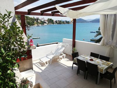 Photo for Apartment Olly beachfront large terrace with 4 sunbeds barbecue and garden