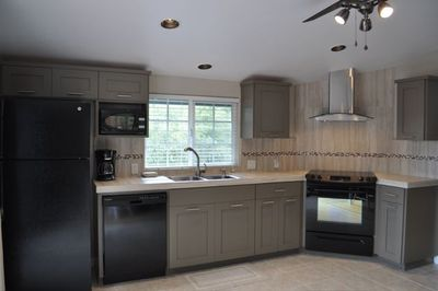 Upscale kitchen features energy star appliances and self-closing cabinet doors.