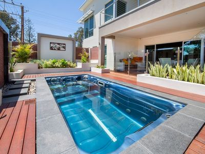 Photo for Glenelg 2 Bedroom Ground Floor Home with Heated Pool, Spa & Large Theatre Room