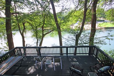 RIVERSIDE ROOST - a SkyRun Texas Property - Large, Shaded Riverfront Deck on the Guadalupe - Complete with river view, gas grill, hammock, and outdoor dining areas