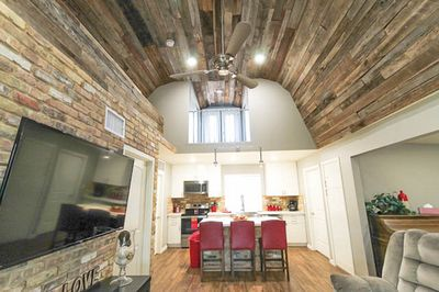 View of the Vaulted Barn wood Ceiling and the Kitchen and living room.