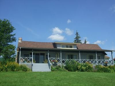 Front of Kildare Cottage facing the Lake with rooms of Waterfront Views