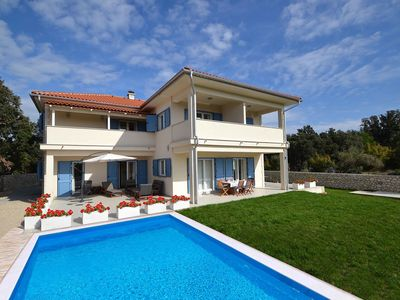 Photo for This 5-bedroom villa for up to 10 guests is located in Rab and has a private swimming pool, air-cond