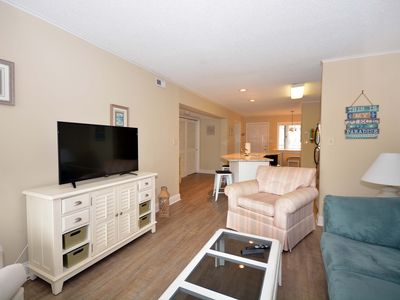 Photo for Peaceful, serenely decorated 2 bedroom condo with free WiFi and an outdoor pool located midtown on the ocean block only a short walk to the beach!