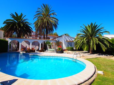 Photo for This 4-bedroom villa for up to 9 guests is located in Empuriabrava and has a private swimming pool,