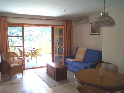 Photo for Welcoming garden apartment with sea and mountain views 5 minutes walk from beac