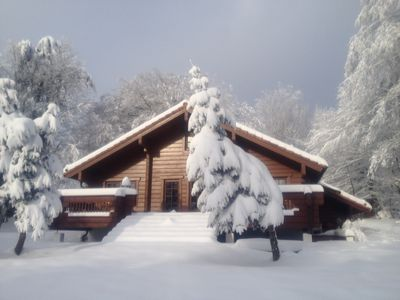 Photo for Log house with fireplace, sauna, large sunny terrace and a huge plot