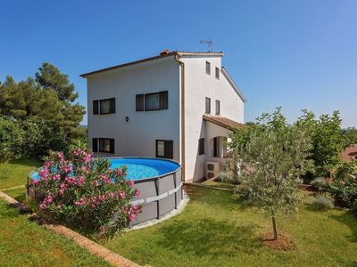 Photo for Pleasant holiday home with above ground swimming pool, at 5 km from Porec and near the beach