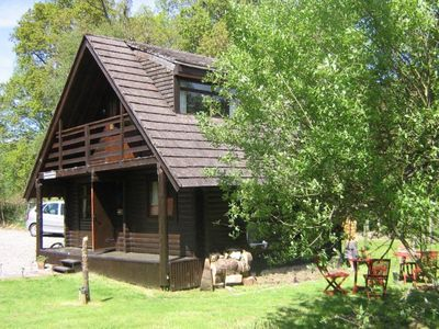 Photo for Balvaig River Log Cabin, with wood burning stove, alpine charm on water's edge