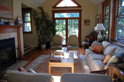 One of 2 living areas, the great room has a fireplace and 14' cathedral ceilings