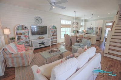 Spacious living area with large TV