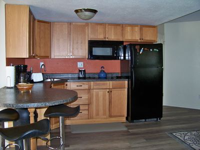 kitchen with stove top, microwave and dishwasher