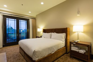 Plush king size bed in this luxury resort room