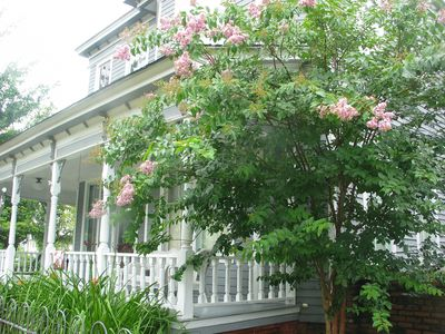front of home with crepe myrtle blooming