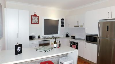 Beautiful updated kitchen with washing machine and dryer.