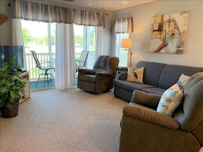 Photo for Sweeping golf course views and 5 miles from the beach!