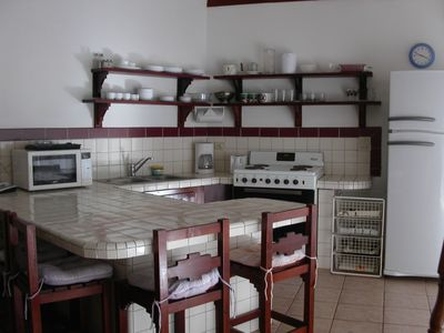 Kitchen fully stocked for six persons, with extra plates and cutlery. Lots of counter space.