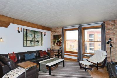 Comfortable, spacious living room with great city view.