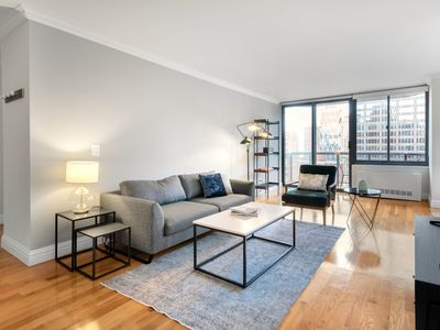 Photo for Bright Midtown 2BR w/ Pool, Gym, Roof Deck, near Subway, by Blueground