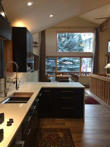 Stunning new kitchen, opens to the dining room and a gorgeous view.