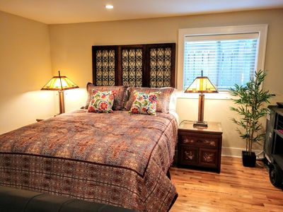 Plush queen bed with fold-out sofa, sleeps 4. Add airbed for two more guests.