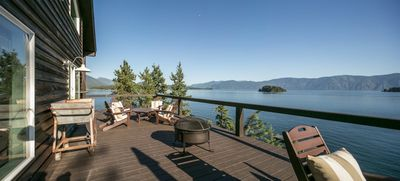 Large deck with ample sitting areas, BBA, fire pit.