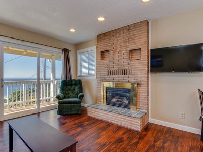 Photo for Dog-friendly condo with ocean view and beach access perfect for family fun!