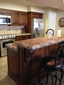 Recently upgraded, kitchen is fully equipped and has bar seating for 4.