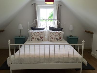 Master Bedroom - King size double bed and good storage.