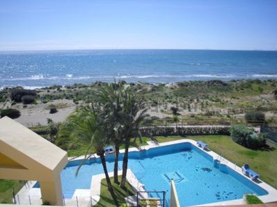 Photo for Beachfront apartment 15m from the sea and 10m from the pool