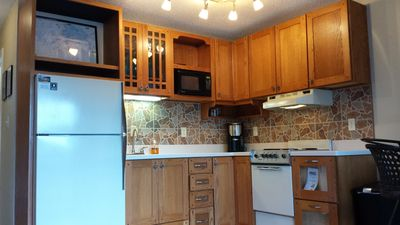Kitchen with Solid Surface Counter Tops. Prepare a Snack or a Full Coarse Meal.