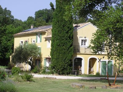 Photo for Provençal Farmhouse surrounded by vines with views of the mountains